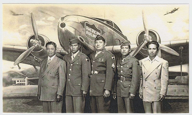 Florentino Ignalan and friends in uniform, standing in front of an airplane