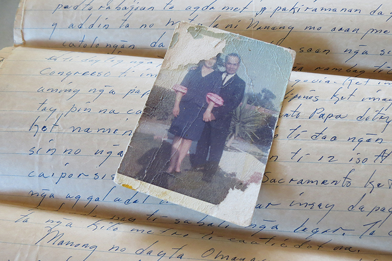 A photograph of a couple on top of a written letter